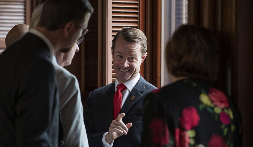 House Speaker Dade Phelan, R-Beaumont, talks to Republican members of the Texas House before the start of the debate of Senate Bill 7, known as the Election Integrity Protection Act, at the Capitol on Sunday, May 30, 2021, in Austin, Texas. (Jay Janner/Austin American-Statesman via AP)