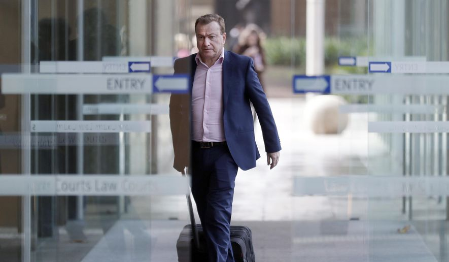 In this May 6, 2021, file photo, Andrew Cooper, founder and president of libertarian group LibertyWorks, arrives at Federal Court in Sydney. An Australian court on Tuesday, June 1, 2021, has rejected a challenge to the federal government's draconian power to prevent most citizens from leaving the country so that they don't bring COVID-19 home. (AP Photo/Rick Rycroft, File)