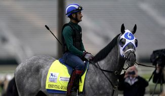 Kentucky Derby entrant Essential Quality waits to work out at Churchill Downs in Louisville, Ky., in this Thursday, April 29, 2021, file photo. Essential Quality was set as a 2-1 favorite for the Belmont Stakes. Essential Quality went off as the Derby favorite and finished fourth. (AP Photo/Charlie Riedel, File) **FILE**