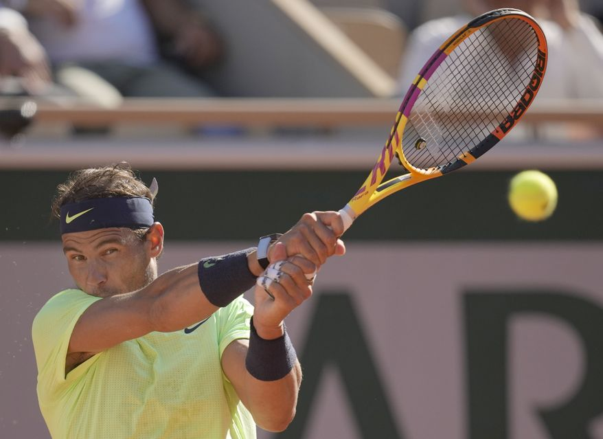 Spain's Rafael Nadal plays a return to Australia's Alexei Popyrin during their first round match on day three of the French Open tennis tournament at Roland Garros in Paris, France, Tuesday, June 1, 2021. (AP Photo/Christophe Ena)