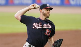 Washington Nationals starting pitcher Stephen Strasburg (37) delivers ion the first inning of a baseball game against the Atlanta Braves Tuesday, June 1, 2021, in Atlanta. (AP Photo/John Bazemore) **FILE**