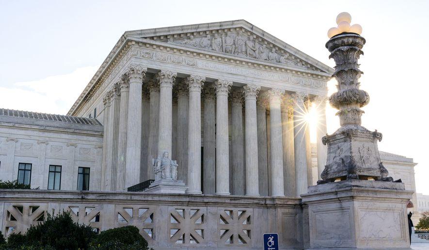 In this Nov. 10, 2020, file photo the sun rises behind the U.S. Supreme Court in Washington.  (AP Photo/Alex Brandon, File)