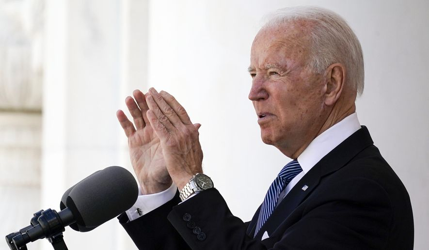President Joe Biden speaks at Arlington National Cemetery on Memorial Day, Monday, May 31, 2021, in Arlington, Va. Biden on Tuesday will take part in a remembrance of one of the nation's darkest — and largely forgotten — moments of racial violence, marking the 100th anniversary of a massacre in Tulsa, Oklahoma, that wiped out a thriving Black community. (AP Photo/Alex Brandon)