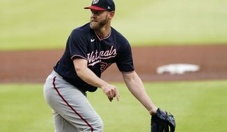Washington Nationals starting pitcher Stephen Strasburg reacts after giving up a double in the first inning of a baseball game Tuesday, June 1, 2021, in Atlanta. (AP Photo/John Bazemore)
