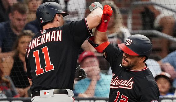 Washington Nationals' Ryan Zimmerman (11) celebrates with Kyle Schwarber (12) after hitting a two-run home run in the fourth inning of a baseball game against the Atlanta Braves Tuesday, June 1, 2021, in Atlanta. (AP Photo/John Bazemore)