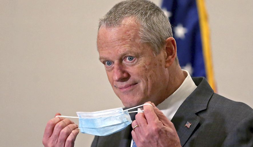 In this April 6, 2021, file photo, Massachusetts Gov. Charlie Baker speaks to reporters after receiving a Pfizer COVID-19 vaccine at the Hynes Convention Center in Boston. Gov. Baker is facing increasing criticism of his handling of the COVID-19 outbreak at the Holyoke Soldiers' Home, with calls mounting for a legislative response to the deaths, which claimed the lives of 76 veteran residents last spring. (Matt Stone/Boston Herald via AP, Pool, File)