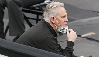 Danny Ainge, Boston Celtics president of basketball operations, watches from a sideline seat during the second half of an NBA basketball game against the Orlando Magic in Boston, in this Friday, Jan. 15, 2021, file photo. The Boston Celtics are beginning their offseason with a shakeup of the front office and coaching staff, with team president Danny Ainge stepping down and coach Brad Stevens moving into the front office, a person with direct knowledge of the moves said Wednesday, June 2, 2021.  (AP Photo/Elise Amendola, File) **FILE**