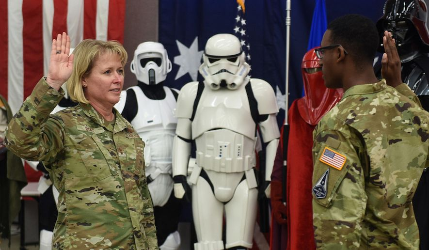 Maj. Gen. DeAnna Burt is sworn into the U.S. Space Force at Vandenberg Air Force Base in California. Closely monitoring the event are a pair of Storm Troopers, the ruthless infantry soldiers of the Empire along with a member of the dreaded Red Guard, Emperor Palpatine's personal security detail. (Courtesy of the Department of Defense)