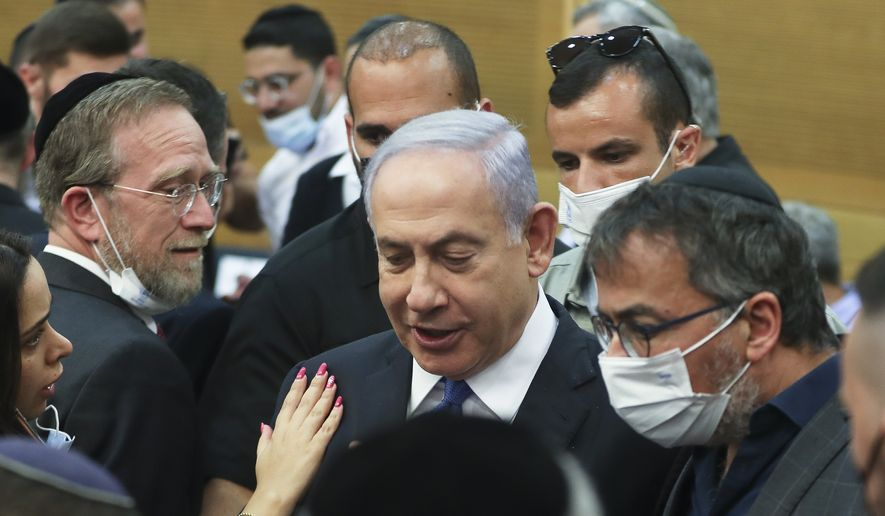Israeli Prime Minister Benjamin Netanyahu looks on after a special session of the Knesset whereby Israeli lawmakers elected a new president, at the Knesset, Israel's parliament, in Jerusalem Wednesday,  June 2, 2021. (Ronen Zvulun/Pool Photo via AP)