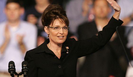Then-Alaska Gov. Sarah Palin waves after delivering her speech on August 30, 2008 following her debut as Sen. John McCain's vice-presidential running mate. (Associated Press)