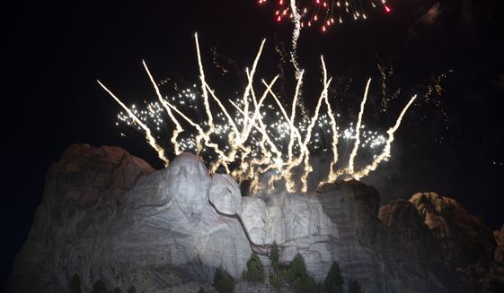 In this July 3, 2020, file photo, fireworks light the sky over the Mount Rushmore National Memorial near Keystone, S.D. A federal judge on Wednesday, June 2, 2021, rebuffed South Dakota Gov. Kristi Noem's efforts to force the National Park Service to grant the state permission to shoot fireworks from Mount Rushmore National Memorial to celebrate Independence Day this year. (AP Photo/Alex Brandon File)