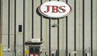 In this Oct. 12, 2020, file photo, a worker heads into the JBS meatpacking plant in Greeley, Colo.  A weekend ransomware attack on the world's largest meat company is disrupting production around the world just weeks after a similar incident shut down a U.S. oil pipeline. The White House confirms that Brazil-based meat processor JBS SA notified the U.S. government Sunday, May 30, 2021, of a ransom demand from a criminal organization likely based in Russia.  (AP Photo/David Zalubowski, File)