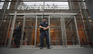 A police officer stands outside The New York Times building in New York, June 28, 2018. Trump Justice Department secretly obtained the phone records of four New York Times journalists as part of a leak investigation, the newspaper said Wednesday, June 2, 2021. (AP Photo/Mary Altaffer) ** FILE **