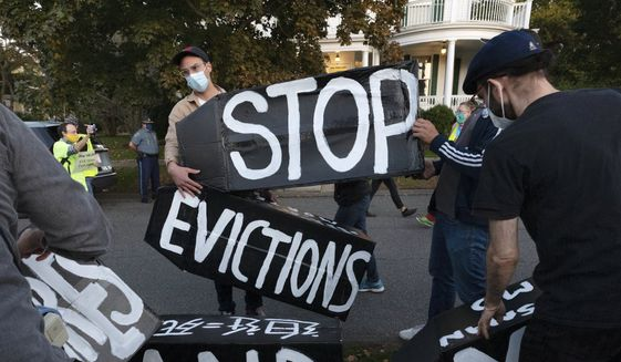 In this Oct. 14, 2020, file photo, housing activists erect a sign in front of Massachusetts Gov. Charlie Baker's house in Swampscott, Mass. On July 23, 2021, the Cincinnati-based 6th Circuit Court of Appeals upheld a lower court's decision that the government agency overstepped its authority by ordering a nationwide eviction moratorium to protect tenants about to lose their homes, an order which is set to expire at the end of July.  (AP Photo/Michael Dwyer, File)