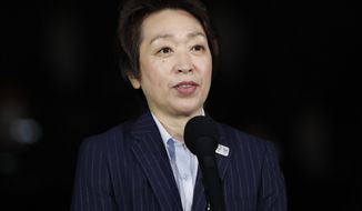 Seiko Hashimoto, President of the Tokyo 2020 Organizing Committee of the Olympic and Paralympic Games, delivers a speech during an unveiling event for the elements that will be used during the victory ceremonies in the Tokyo 2020 Olympic and Paralympic Games at the Ariake Arena, in Tokyo, Thursday, June 3, 2021. (Issei Kato/Pool Photo via AP)