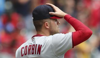 Washington Nationals starting pitcher Patrick Corbin reacts while watching a two-run home run by Atlanta Braves batter Dansby Swanson leave the park during a baseball game, Thursday, June 3, 2021, in Atlanta. (Curtis Compton/Atlanta Journal-Constitution via AP)