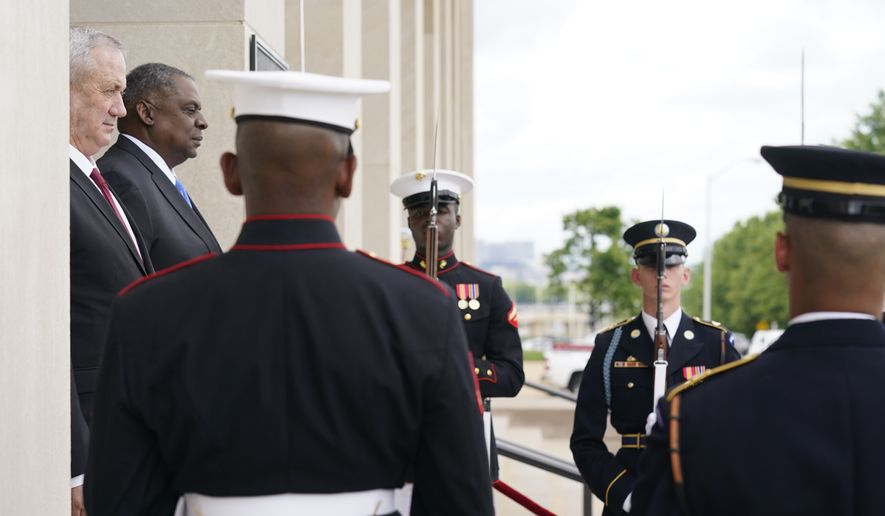 Secretary of Defense Lloyd Austin hosts an honor cordon welcoming Israeli Defense Minister Benny Gantz at the Pentagon in Washington, Thursday, June 3, 2021. (AP Photo/Andrew Harnik) **FILE**