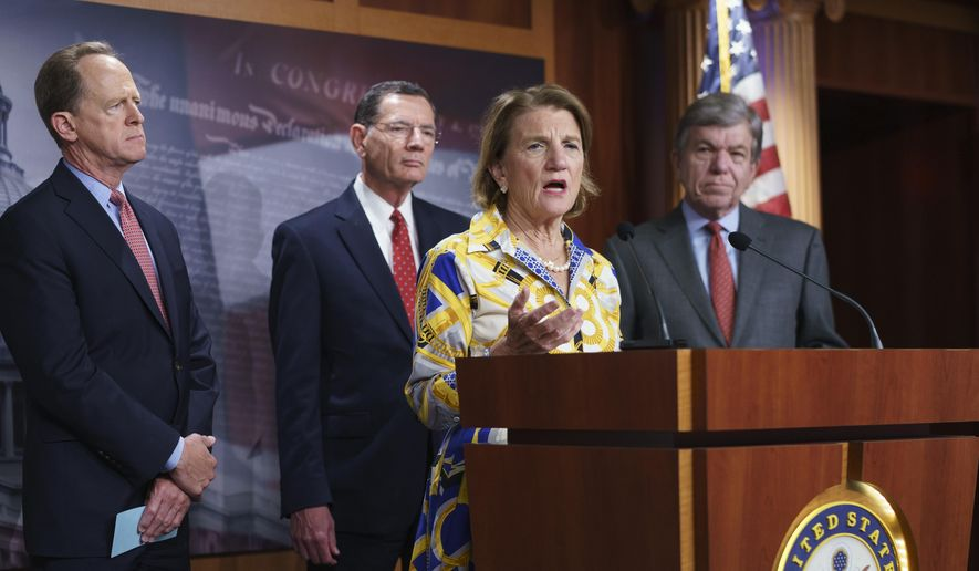 In this photo taken Thursday, May 27, 2021, Sen. Shelley Moore Capito, R-W.Va., the GOP's lead negotiator on a counteroffer to President Joe Biden's infrastructure plan, speaks at a news conference as she is joined by, from left, Sen. Pat Toomey, R-Pa., Sen. John Barrasso, R-Wyo., chairman of the Senate Republican Conference, and Sen. Roy Blunt, R-Mo., at the Capitol in Washington. (AP Photo/J. Scott Applewhite) ** FILE **