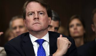 In this Sept. 27, 2018, file photo, then-White House counsel Don McGahn listens as Supreme Court nominee Brett Kavanaugh testifies before the Senate Judiciary Committee on Capitol Hill in Washington. After years of trying, the House Judiciary Committee is set to question McGahn on June 4, 2021, two years after House Democrats originally sought his testimony as part of investigations into former President Donald Trump. (Saul Loeb/Pool Photo via AP, File)