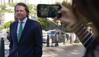 Former White House counsel Don McGahn departs after appearing for questioning behind closed doors by the House Judiciary Committee on Capitol Hill in Washington, Friday, June 4, 2021. (AP Photo/Patrick Semansky)