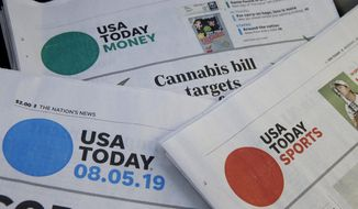 In this Aug. 5, 2019, file photo, sections of a USA Today newspapers in Norwood, Mass. The FBI issued a subpoena demanding U.S. newspaper giant Gannett provide agents with information to track down readers of a USA Today story about a suspect in a child pornography case who fatally shot two FBI agents in February.  (AP Photo/Steven Senne, File)