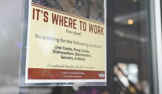 A sign for hiring is dipslayed on a door as patrons walk into Yours Truly restaurant, Thursday, June 3, 2021, in Chagrin Falls, Ohio. The number of Americans seeking unemployment benefits fell last week for a fifth straight week to a new pandemic low, the latest evidence that the U.S. job market is regaining its health as the economy further reopens. (AP Photo/Tony Dejak)