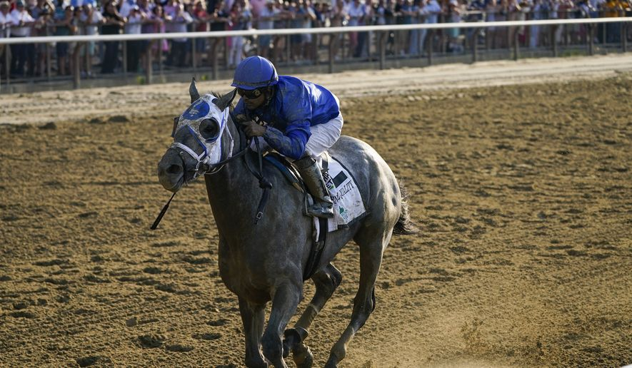 Essential Quality (2), with jockey Luis Saez up, crosses the finish line to win the 153rd running of the Belmont Stakes horse race, Saturday, June 5, 2021, at Belmont Park in Elmont, N.Y. (AP Photo/Seth Wenig) **FILE**