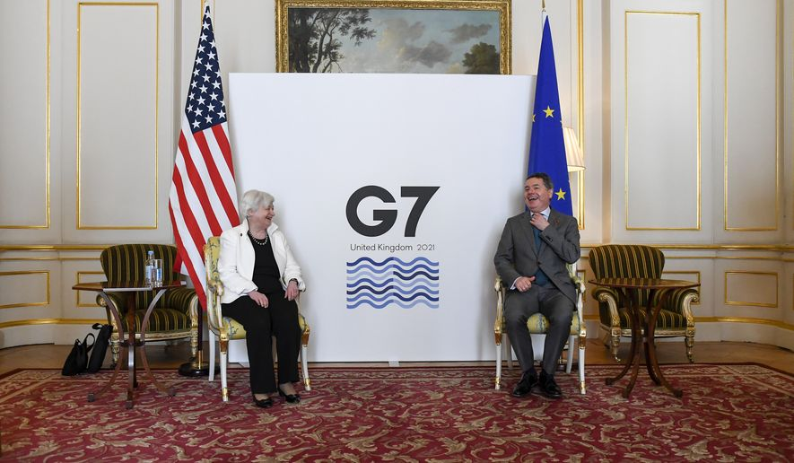 U.S. Treasury Secretary, Janet Yellen, left, and Eurogroup President Paschal Donohoe share a light moment as finance ministers from across the G7 nations meet at Lancaster House, in London, Saturday, June 5, 2021, ahead of the G7 leaders' summit. (AP Photo/Alberto Pezzali, Pool) **FILE**