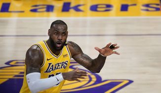 Los Angeles Lakers forward LeBron James (23) reacts to a call during Game 6 of an NBA basketball first-round playoff series against the Phoenix Suns Thursday, Jun 3, 2021, in Los Angeles. (AP Photo/Ashley Landis) **FILE**