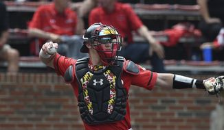 Maryland catcher Justin Vought during an NCAA baseball game on Saturday, May 18, 2019 in Baltimore. (AP Photo/Gail Burton) **FILE**