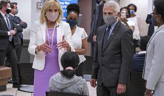First lady Jill Biden, center left, and Dr. Anthony Fauci, director of the National Institute of Allergy and Infectious Diseases, speak to a person as they visit a vaccine clinic at the Abyssinian Baptist Church in the Harlem neighborhood of New York Sunday, June 6, 2021. (AP Photo/Craig Ruttle)