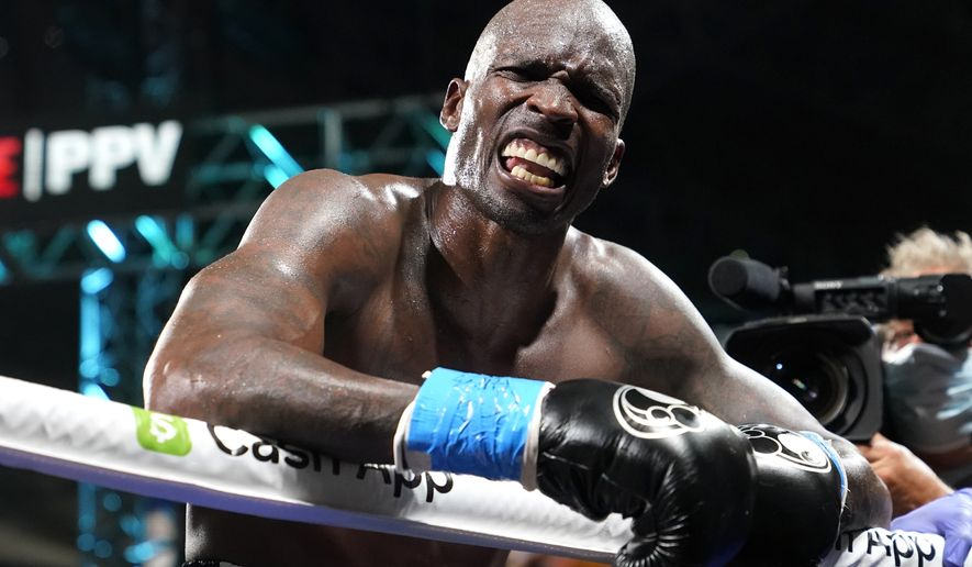 Former NFL wide receiver Chad Johnson reacts after an exhibition boxing match against Brian Maxwell at Hard Rock Stadium, Sunday, June 6, 2021, in Miami Gardens, Fla. (AP Photo/Lynne Sladky)