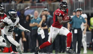 Atlanta Falcons wide receiver Julio Jones (11) runs toward the end zone for a touchdown against Philadelphia Eagles free safety Rodney McLeod (23) during the second half of an NFL football game in Atlanta, in this Sunday, Sept. 15, 2019, file photo. The Tennessee Titans have traded with the Atlanta Falcons for seven-time Pro Bowl wide receiver Julio Jones, a person familiar with the situation told The Associated Press. (AP Photo/John Bazemore, File) **FILE**