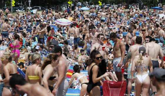 Crowds gather on L Street Beach, Saturday, June 5, 2021, in the South Boston neighborhood of Boston. New England is giving the rest of the country a possible glimpse into the future if more Americans get vaccinated. The six-state region has among the highest vaccination rates in the U.S. and is seeing sustained drops in COVID-19 cases, hospitalizations and deaths. (AP Photo/Michael Dwyer) **FILE**