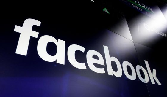 The Facebook logo on screens at the Nasdaq MarketSite, in New York City's Times Square. (AP Photo/Richard Drew, File)