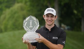 Patrick Cantlay holds the trophy after winning the Memorial golf tournament, Sunday, June 6, 2021, in Dublin, Ohio. (AP Photo/Darron Cummings) **FILE**