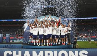 The United States celebrates a 3-2 win against Mexico in extra time in the CONCACAF Nations League championship soccer match, Sunday, June 6, 2021, in Denver. (AP Photo/Jack Dempsey)