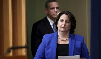 Deputy Attorney General Lisa Monaco is followed by FBI Deputy Director Paul Abbate as she arrives to announce the recovery of millions of dollars worth of cryptocurrency from the Colonial Pipeline Co. ransomware attacks at the Justice Department in Washington, Monday, June 7, 2021. (Jonathan Ernst/Pool via AP)