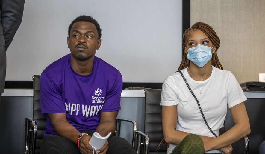 Charmaine Turner, right, and Secoriey Williamson, parents of Secoriea Turner, listen as their lawyers make remarks during a press conference to announce a lawsuit against the city of Atlanta and others for a series of actions that resulted in the death of their 8-year-old Secoriea Turner, Monday, June 7, 2021. (Alyssa PointerAtlanta Journal-Constitution via AP)