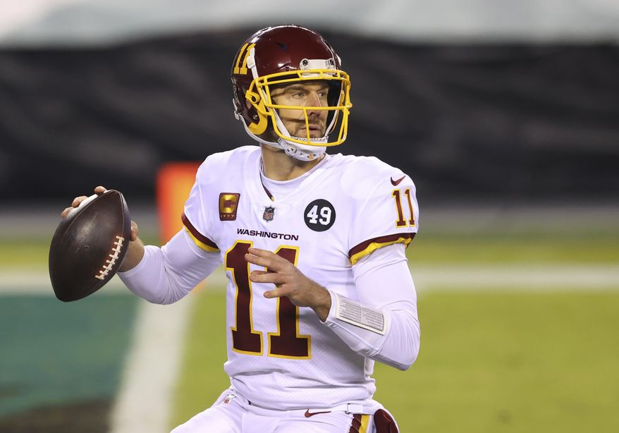 In this Jan. 3, 2021, photo, Washington Football Team quarterback Alex Smith (11) prepares to throw against the Philadelphia Eagles during an NFL football game in Philadelphia. Retired Washington quarterback Smith has won the George Halas Award presented by the Pro Football Writers of America. (AP Photo/Rich Schultz) **FILE**
