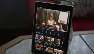 A tablet on the breakfast table of Alparslan Atas and his wife Gulistan at their home in Istanbul shows the latest video of Sedat Peker, a Turkish fugitive crime boss, Sunday, June 6, 2021. (AP Photo/Mehmet Guzel)