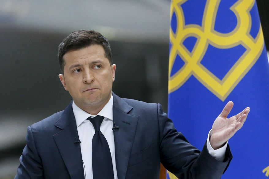 Ukrainian President Volodymyr Zelenskyy gestures while speaking to the media during a news conference with the world's largest airplane, Ukrainian Antonov An-225 Mriya in the background, at the Antonov aircraft factory in Kyiv, Ukraine, Thursday, May 20, 2021. (AP Photo/Efrem Lukatsky)  **FILE**