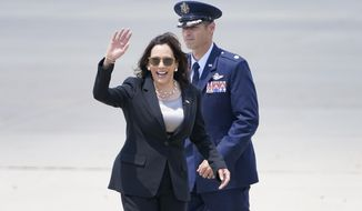 Vice President Kamala Harris waves goodbye prior boarding Air Force Two at Andrews Air Force Base, Md., Sunday, June 6, 2021, en route to Guatemala City. (AP Photo/Jacquelyn Martin)