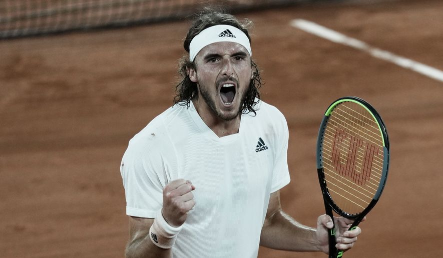 Stefanos Tsitsipas of Greece celebrates after defeating Russia's Daniil Medvedev during their quarterfinal match of the French Open tennis tournament at the Roland Garros stadium Tuesday, June 8, 2021 in Paris. (AP Photo/Thibault Camus)