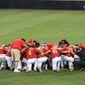 The Maryland baseball team huddles at Clark-LeClair Stadium in Greenville, North Carolina. (Courtesy of Maryland Athletics)