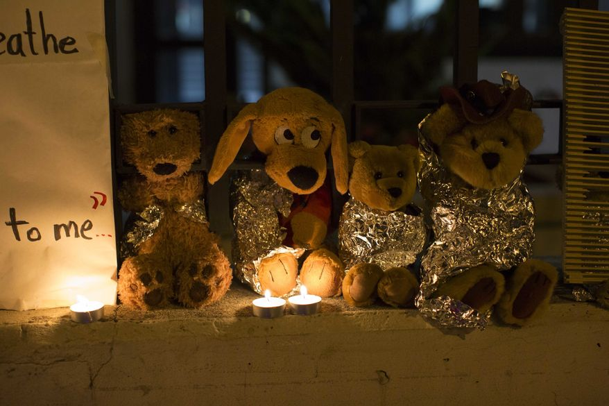 In this Wednesday, June 20, 2018, file photo, stuffed toy animals wrapped in aluminum foil representing migrant children separated from their families are displayed in protest in front of the U.S. Embassy in Guatemala City. In a report released Tuesday, June 8, 2021, the Biden administration says it has identified more than 3,900 children separated at the border under former President Donald Trump's zero-tolerance policy on illegal crossings. (AP Photo/Luis Soto, File)