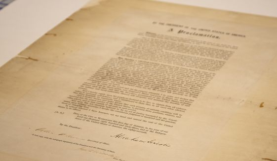This updated handout photo provided by the Abraham Lincoln Presidential Library and Museum on Tuesday, June 8, 2021 shows a signed copy of Emancipation Proclamation. The Library, in Springfield, Ill., will mark Juneteenth, the holiday commemorating the end of slavery in the United States, by displaying the rare signed copy of the Emancipation Proclamation. The copy of the proclamation that's signed by Lincoln and Secretary of State William Seward will be displayed between June 15 and July 6. The original document is kept in the National Archives in Washington, D.C. (Abraham Lincoln Presidential Library and Museum photo via AP)
