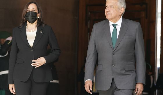 Vice President Kamala Harris walks with Mexican President Andres Manuel Lopez Obrador after arriving Tuesday, June 8, 2021, at the National Palace in Mexico City. (AP Photo/Jacquelyn Martin)