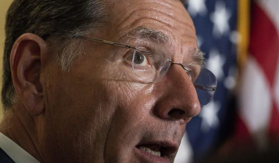 Sen. John Barrasso, R-Wyo., speaks with reporters after a Republican caucus luncheon on Capitol Hill, Tuesday, June 8, 2021, in Washington. (AP Photo/Alex Brandon) **FILE**