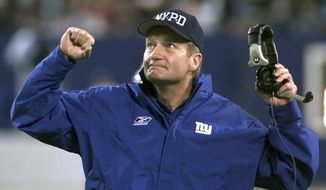 New York Giants head coach Jim Fassel reacts after referees overturned a ruling on a completed Philadelphia Eagles pass in the fourth quarter at Giants Stadium in East Rutherford, N.J., in this Monday, Oct. 22, 2001, file photo. Fassel, a former coach of the New York Giants who was named NFL coach of the year in 1997 and led the team to the 2001 Super Bowl, has died. He was 71. Fassel's son, John, confirmed the death to the Los Angeles Times on Monday, June 7, 2021. According to the Los Angeles Times, Fassel was taken to a hospital in Las Vegas with chest pains and died of a heart attack. (AP Photo/Jeff Zelevansky, File) **FILE**